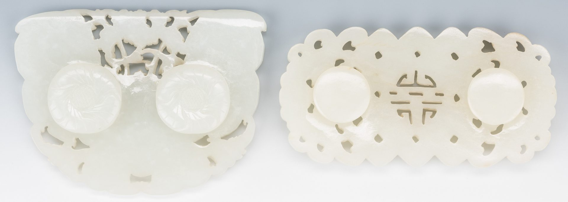 Lot 1: 2 Chinese White/Pale Celadon Carved Belt Buckles