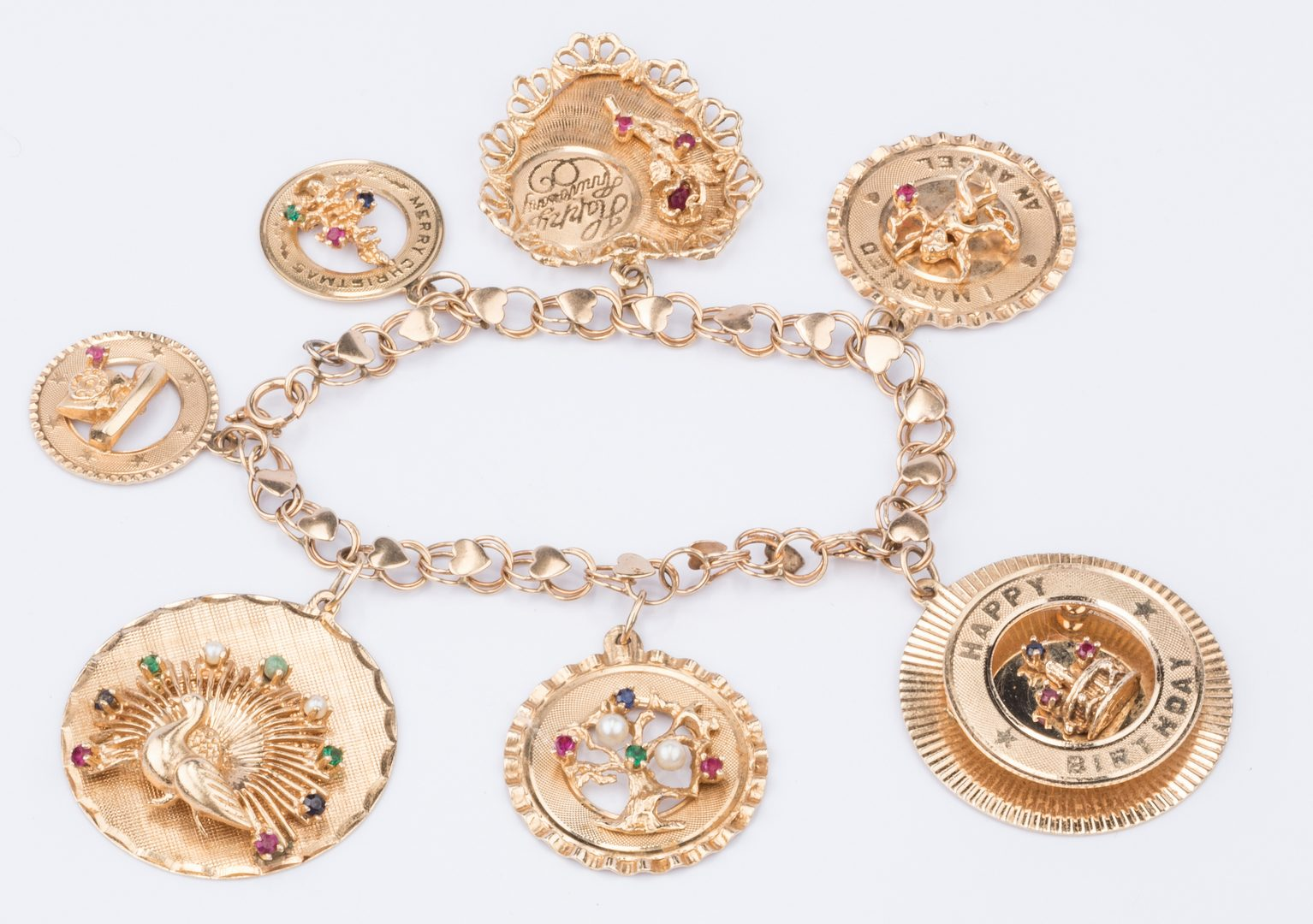 Lot 212: 14K Holiday Charm Bracelet