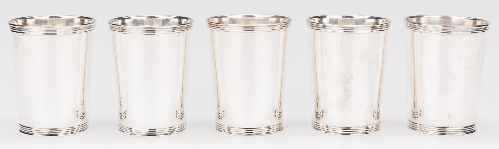 Lot 217: 5 Sterling Juleps with Horseshoe Decoration, Manchester Co.