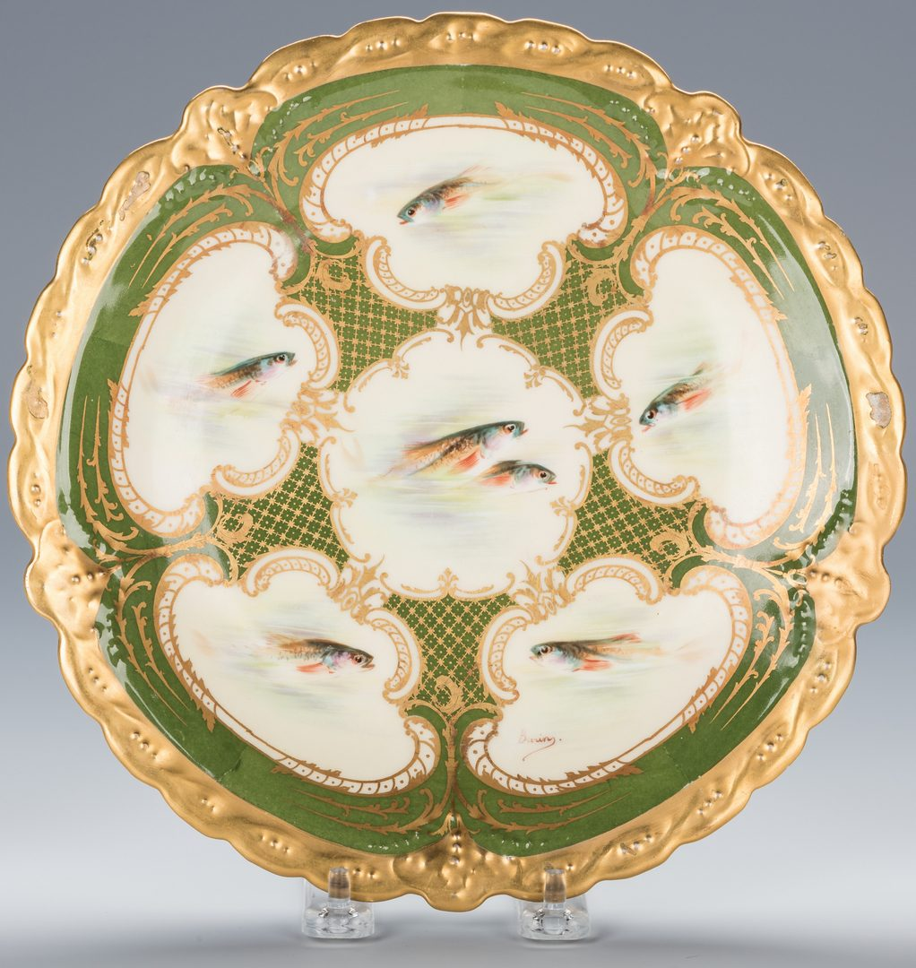 Lot 246: Limoges Fish Set – 12 plates plus platter, artist signed