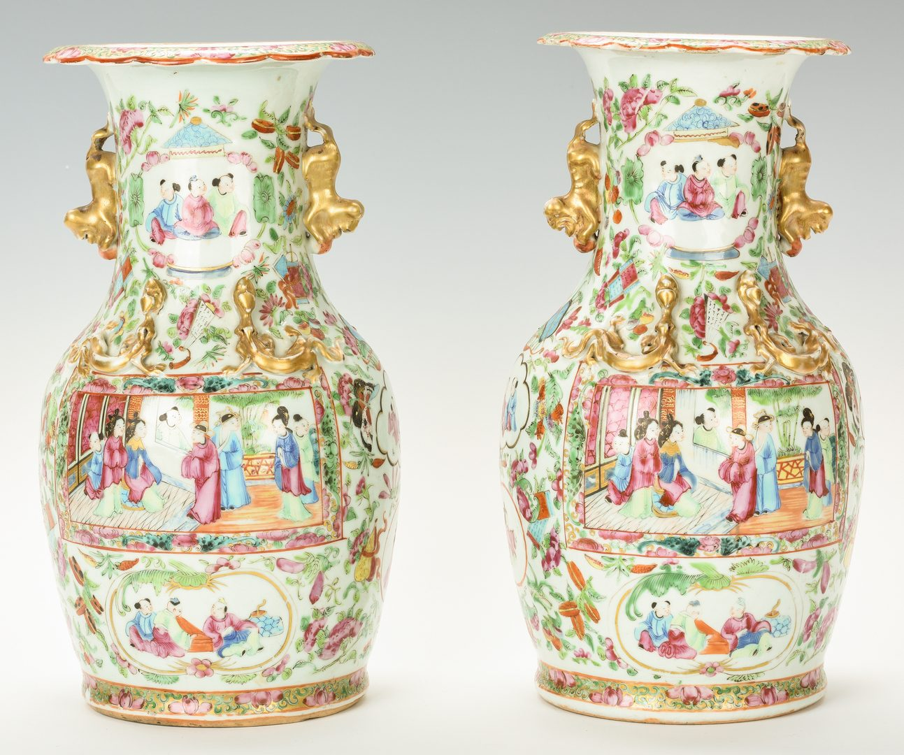 Lot 24: Pr. Chinese Export Rose Mandarin Baluster Vases