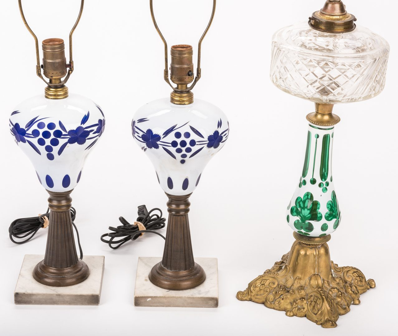 Lot 327: 3 Early 20th Cent. Cased Glass Lamps