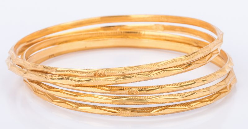 Lot 41: Set Five 22K Gold Bangles