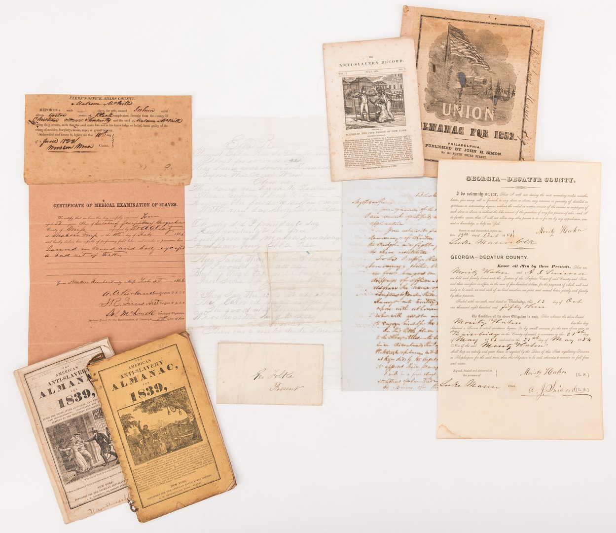 Lot 523: 9 Slave Related Documents & Almanacs