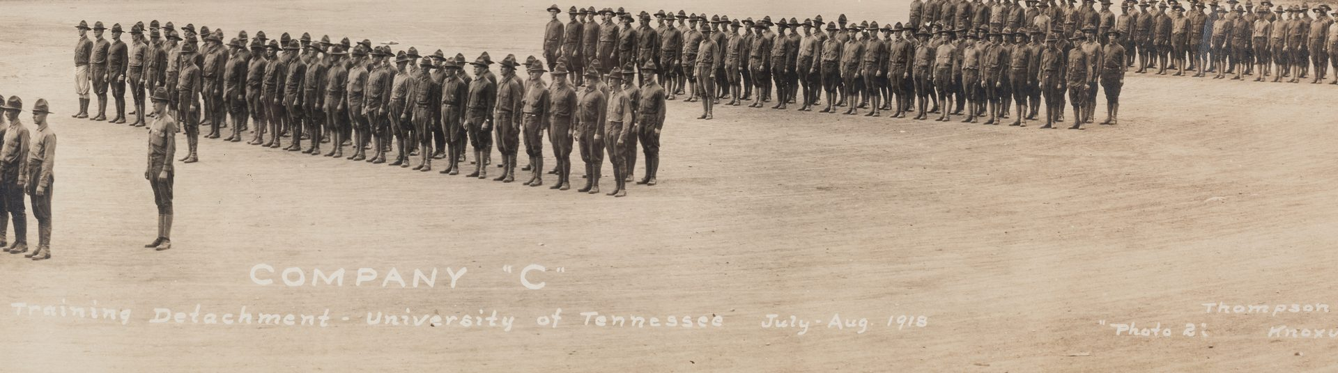 Lot 531: Company C Photo and WWI Poster, 2 items