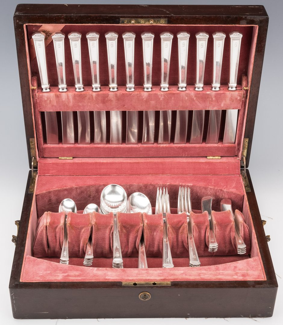 Lot 574: International Sterling Pantheon Flatware service, 63 pcs