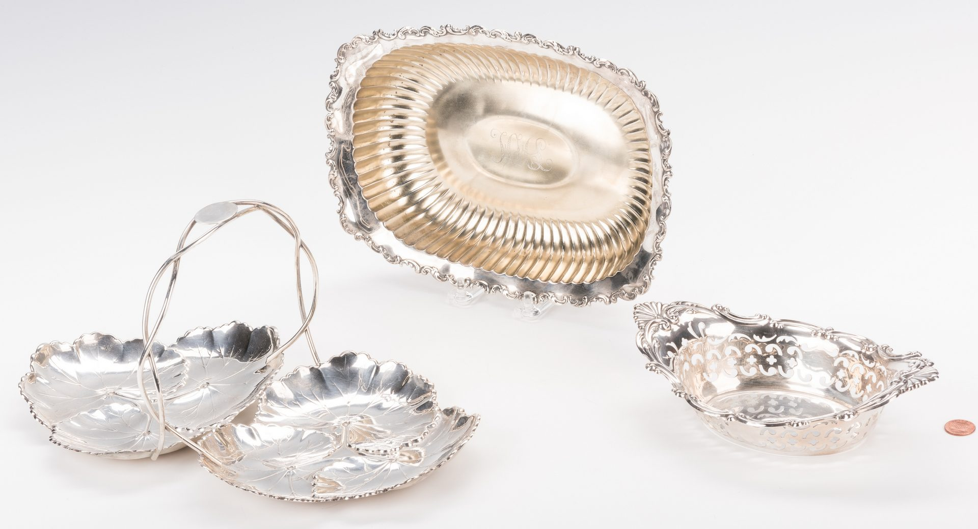 Lot 587: Wirework fruit bowl plus Wine Holder and 16 pieces of sterling