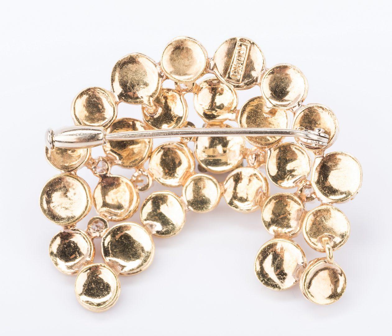 Lot 685: 18K Italian Gold Swirl Pin with Diamonds