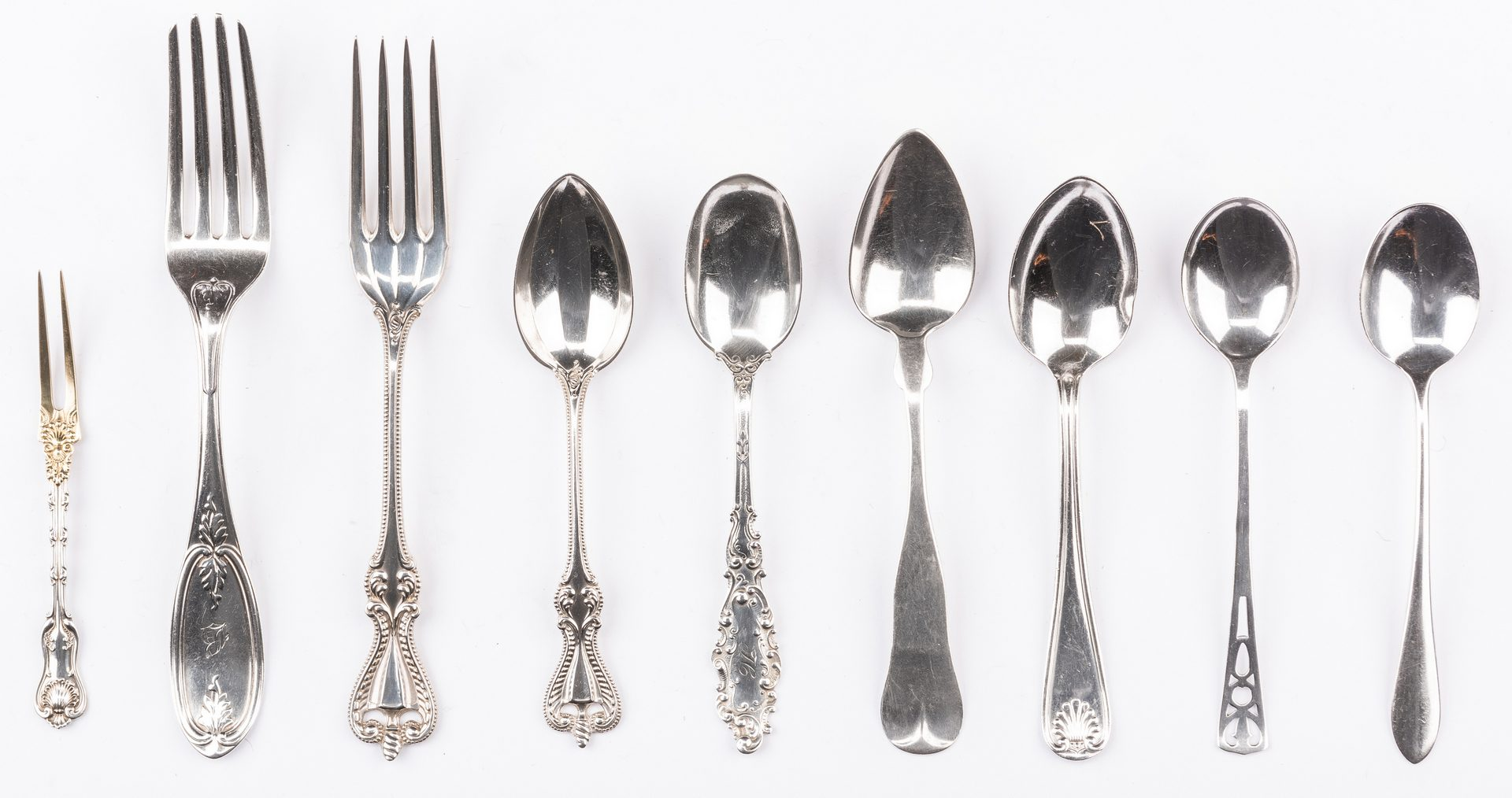 Lot 693: 73 pcs assorted flatware inc. strawberry forks
