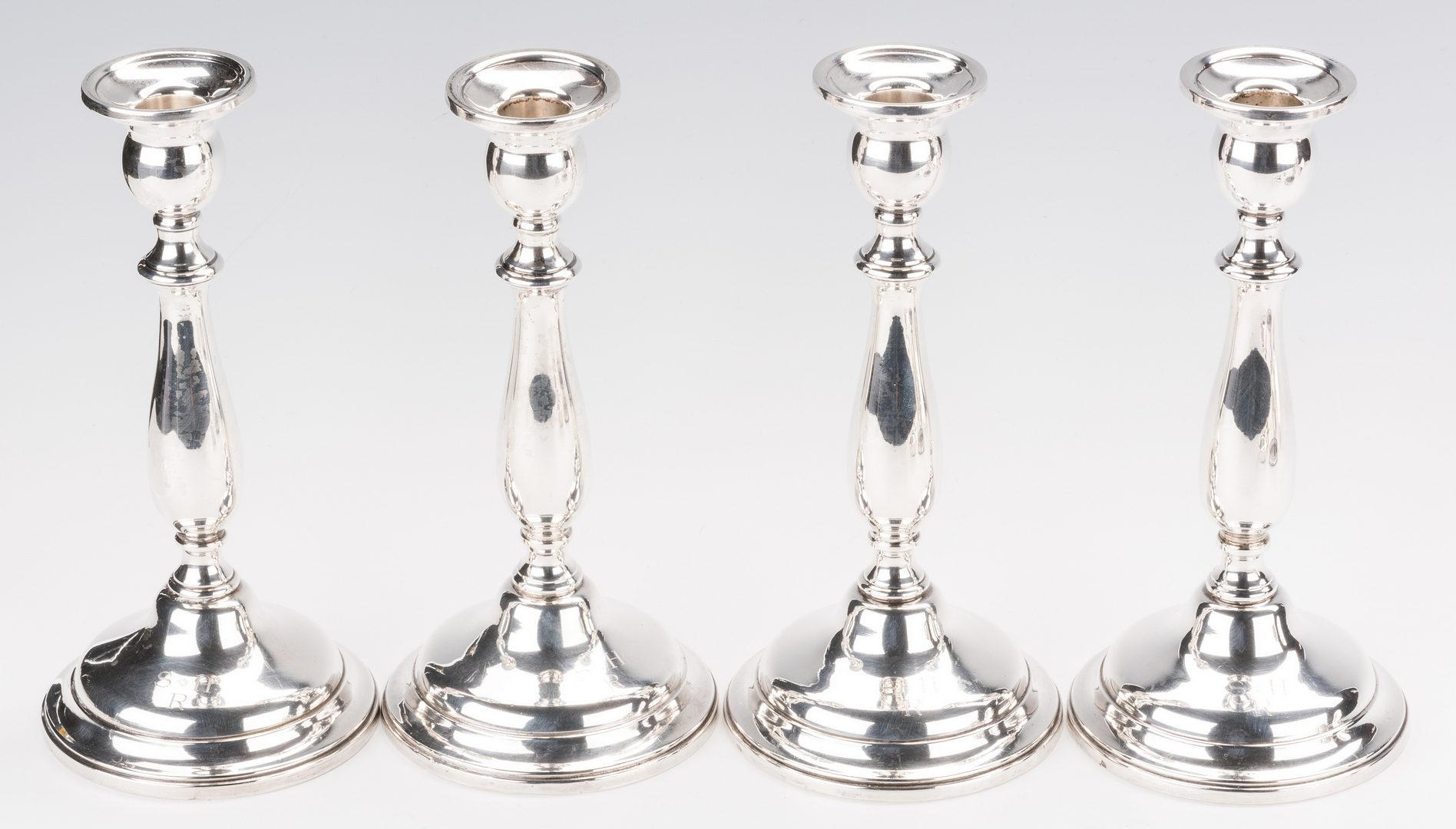 Lot 700: 12 silver items inc. 4 Lord Saybrook sterling candlesticks