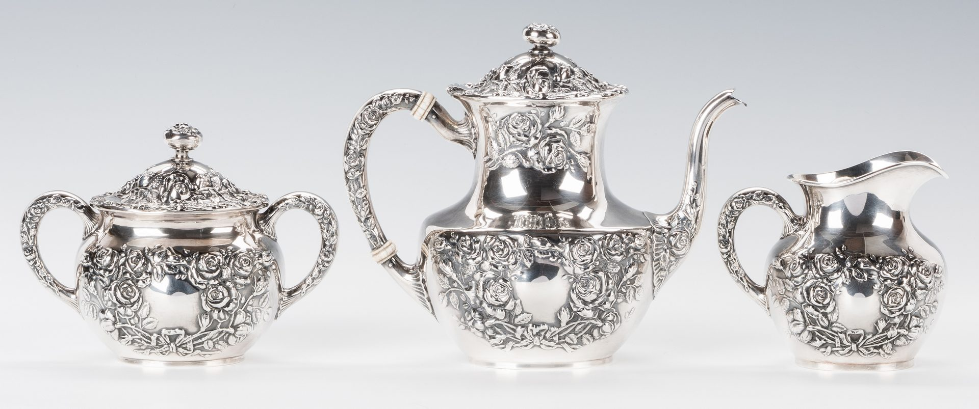 Lot 706: Rose Repousse Sterling Tea Set, 3 pcs