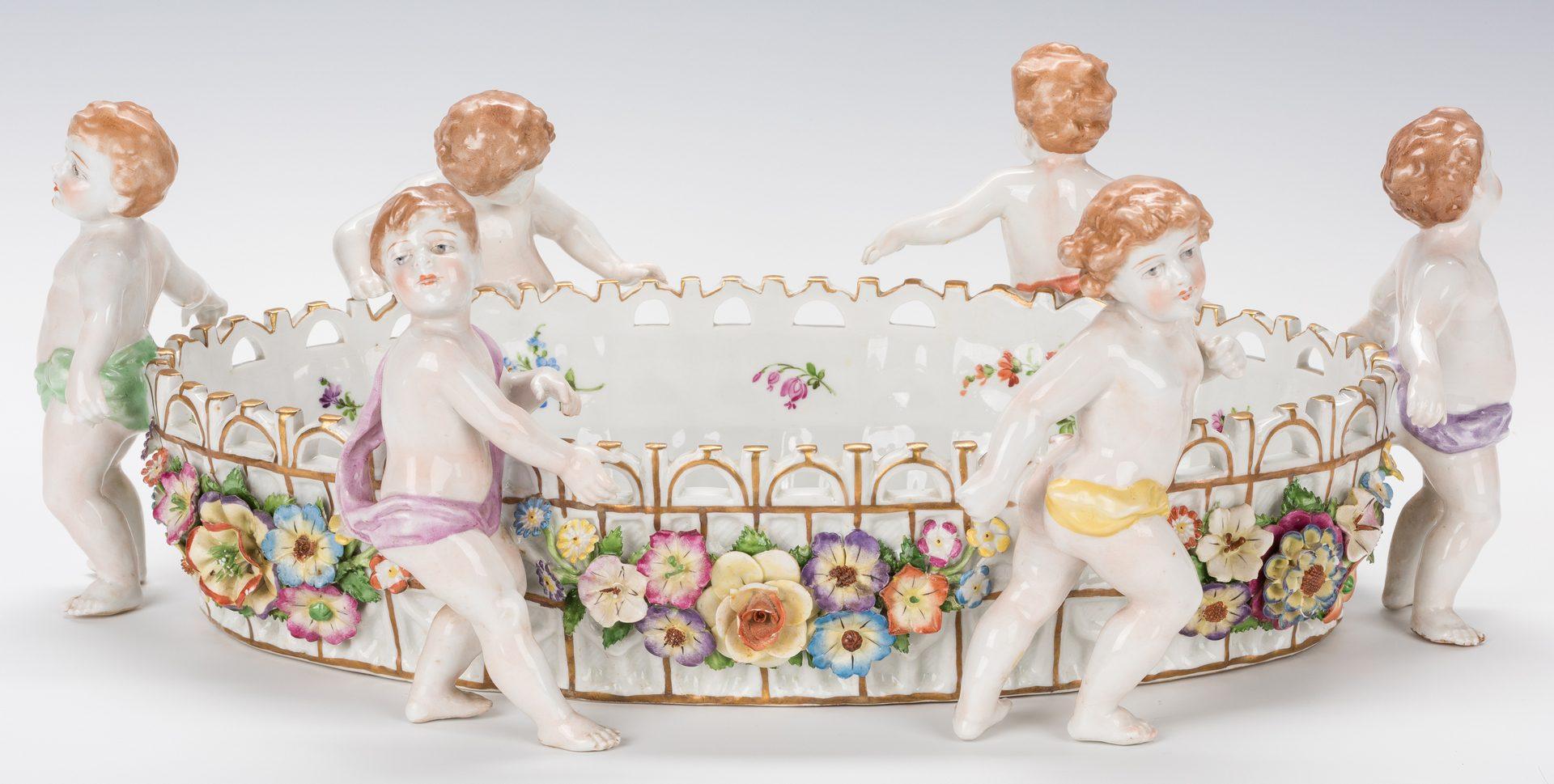 Lot 749: German Porcelain Figural Putti Jardiniere