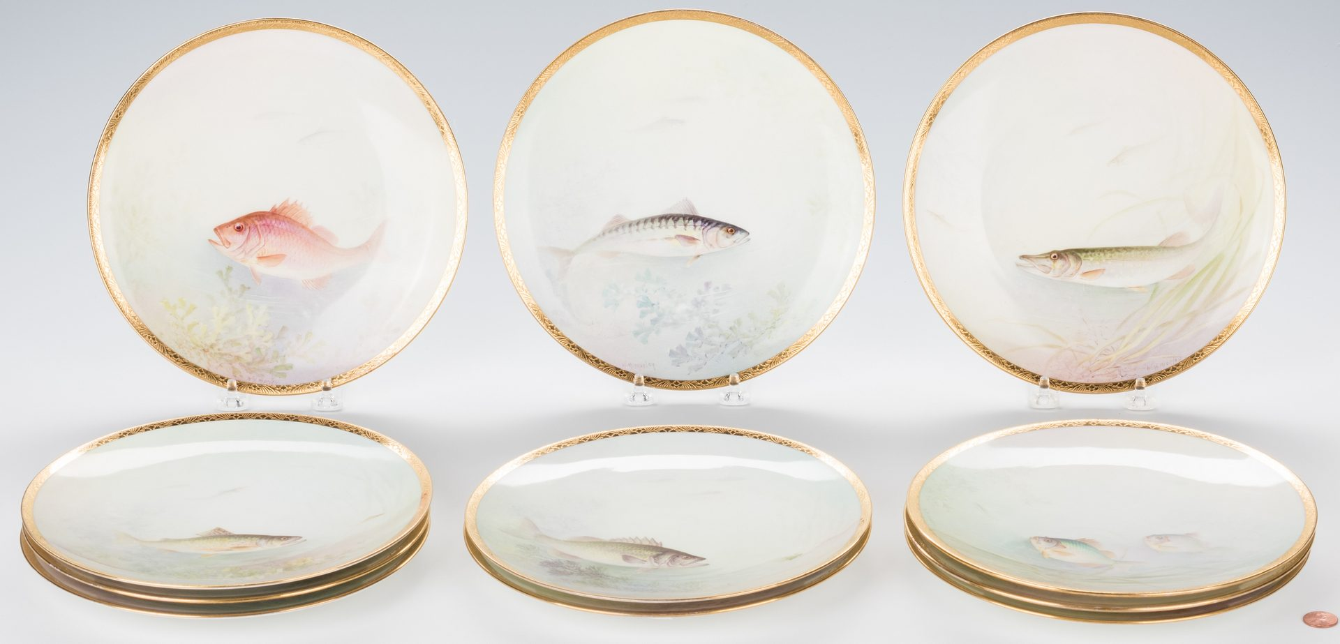 Lot 751: 11 Handpainted Titled Fish Plates plus 6  Menu Holders