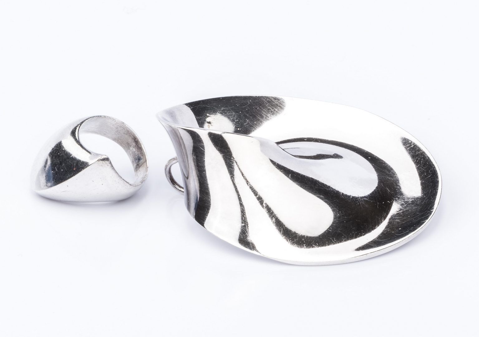 Lot 849: 2 George Jenson Modernist Silver Jewelry Items
