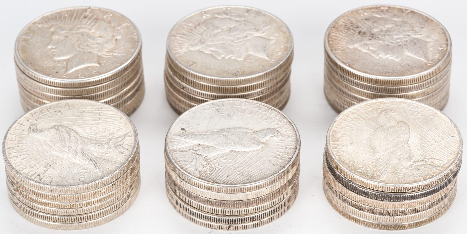 Lot 889: 39 U.S. Peace Silver Dollars (1922-1935)