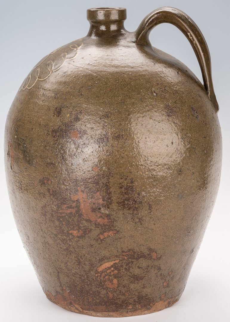 Lot 162: SC Edgefield Pottery Jug w/ Slip Flower Design