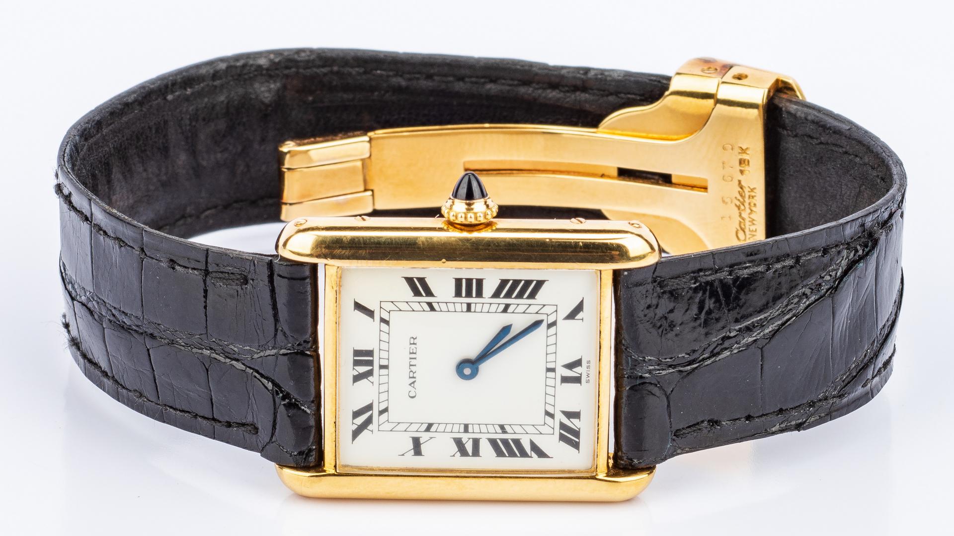 Lot 199: Gents 18K Cartier Tank Watch