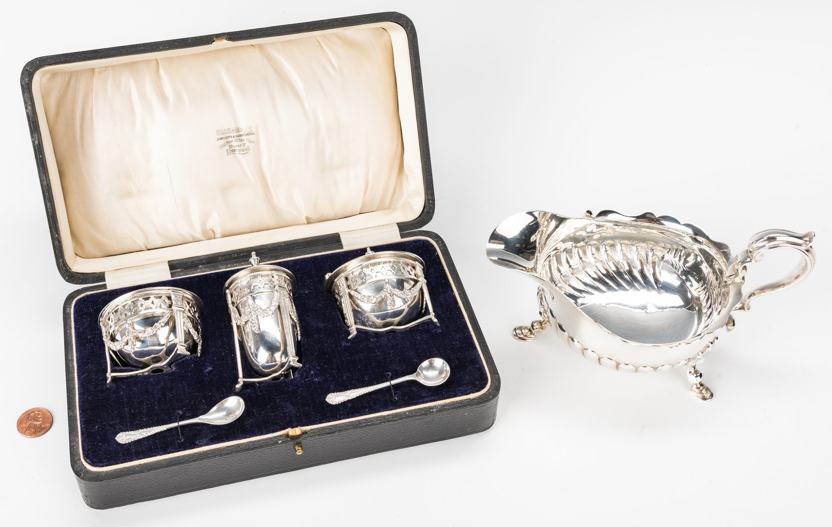 Lot 214: Edwardian Cased Sterling Condiment Set and Sauce Boat