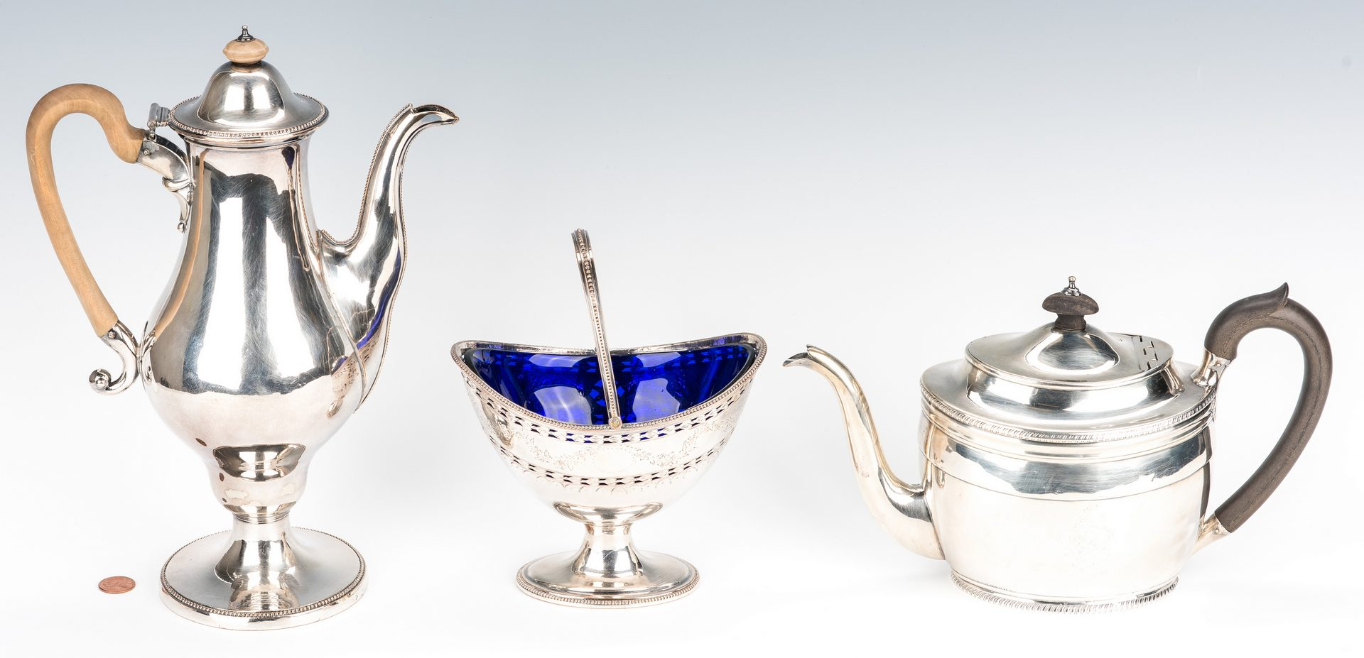 Lot 215: Geo. III Sterling Teapot + OSP coffee pot and sugar