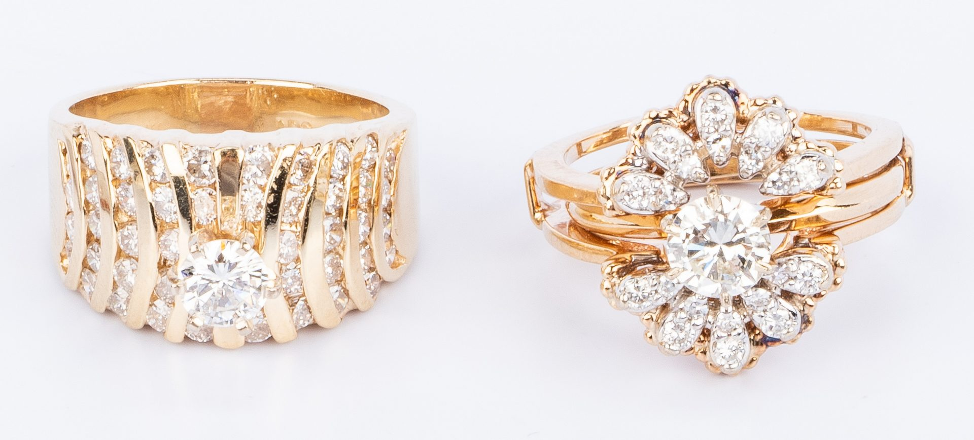 Lot 31: Two 14K Diamond Wedding Rings