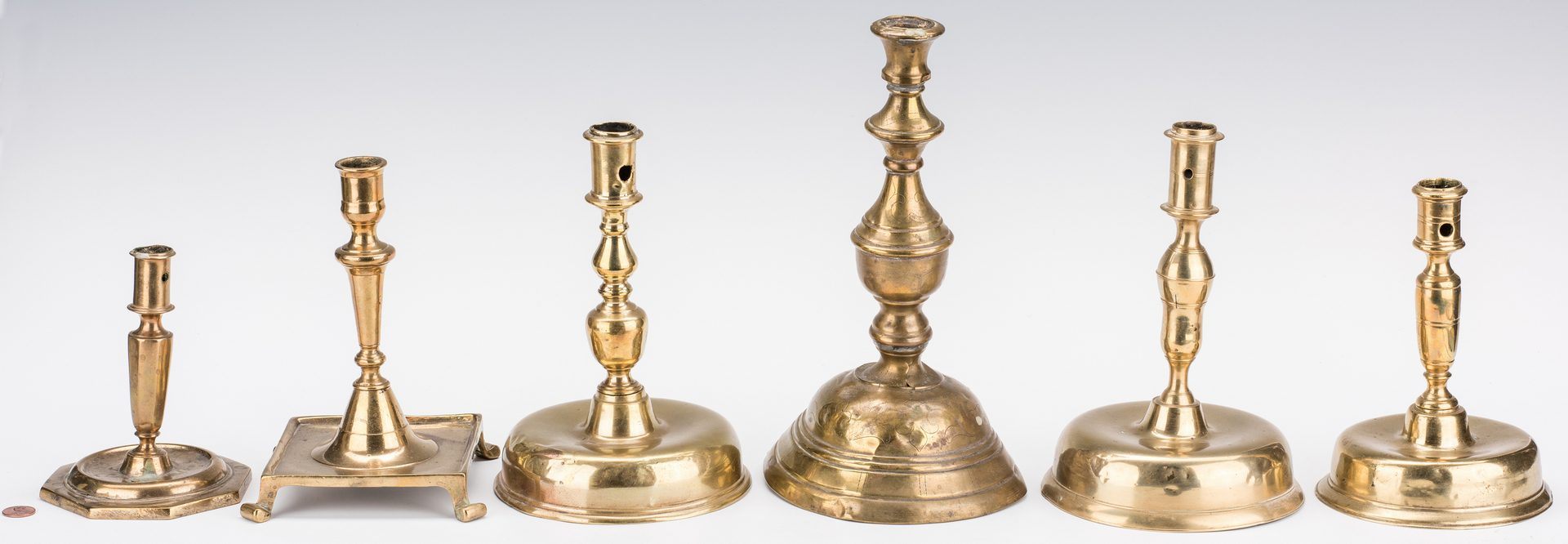 Lot 345: 6 Early Brass Candlesticks