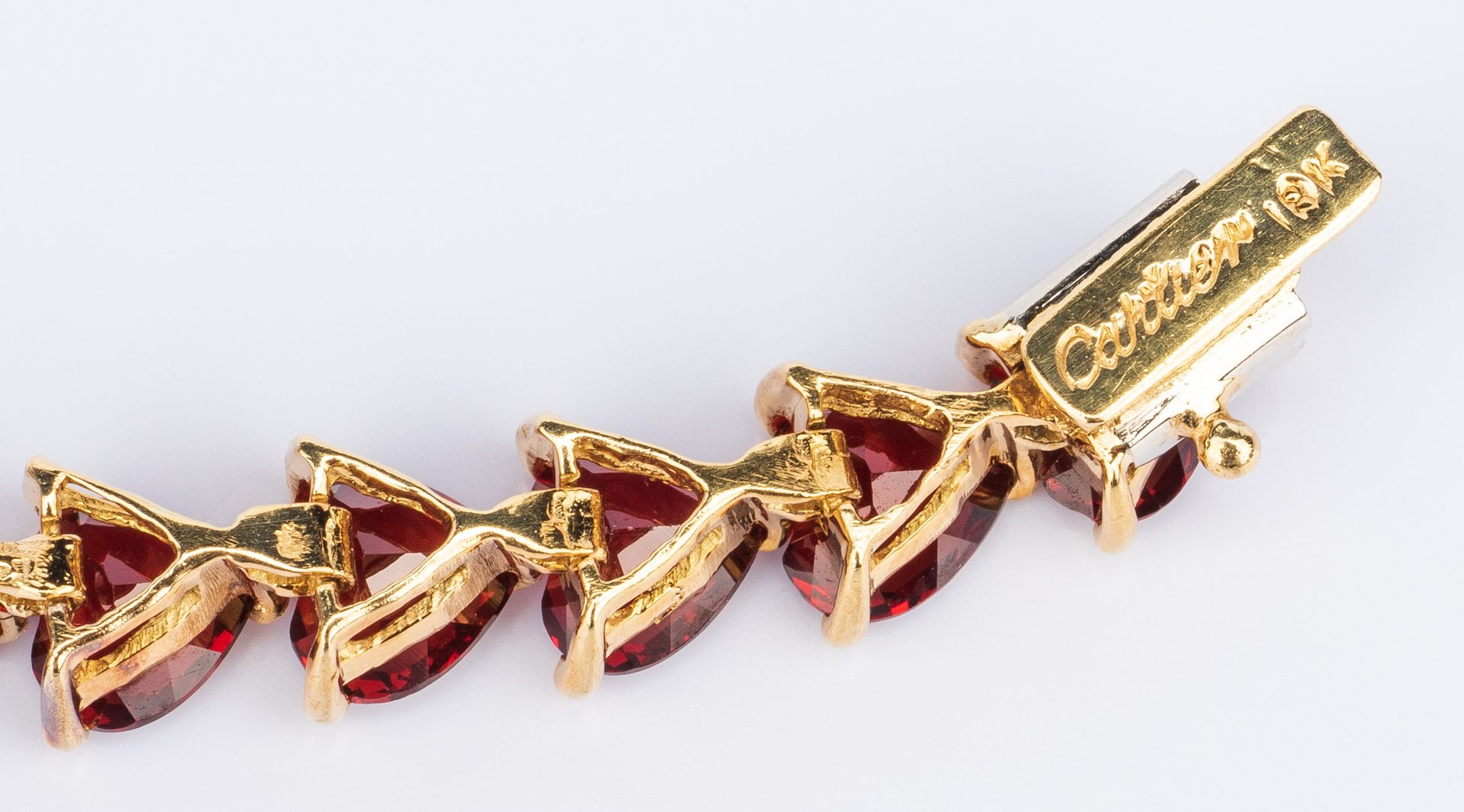 Lot 391: 18K Garnet Bracelet, marked Cartier
