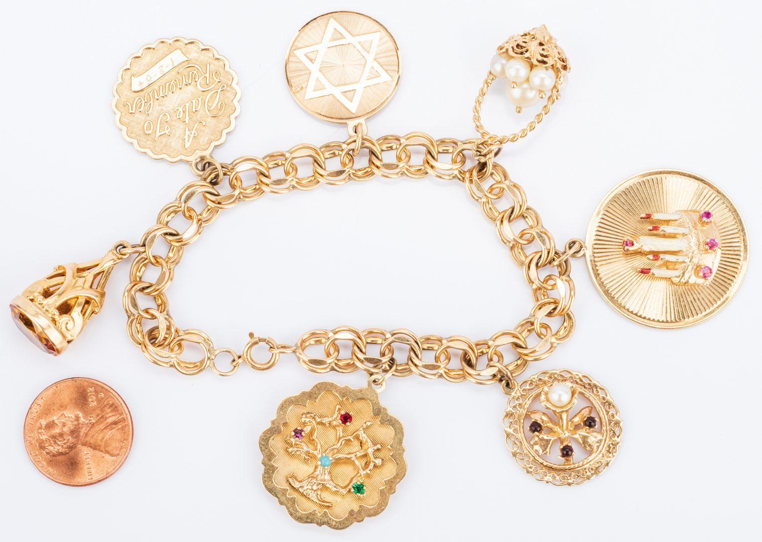 Lot 392: 14K Charm Bracelet, Judaica themes