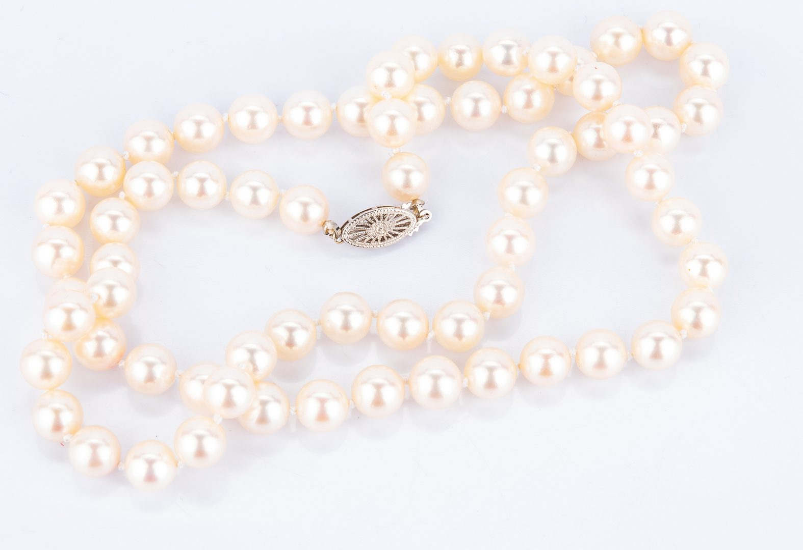 "Lot 398: Mikimoto 24"" 8 x 8.5 mm Pearls"
