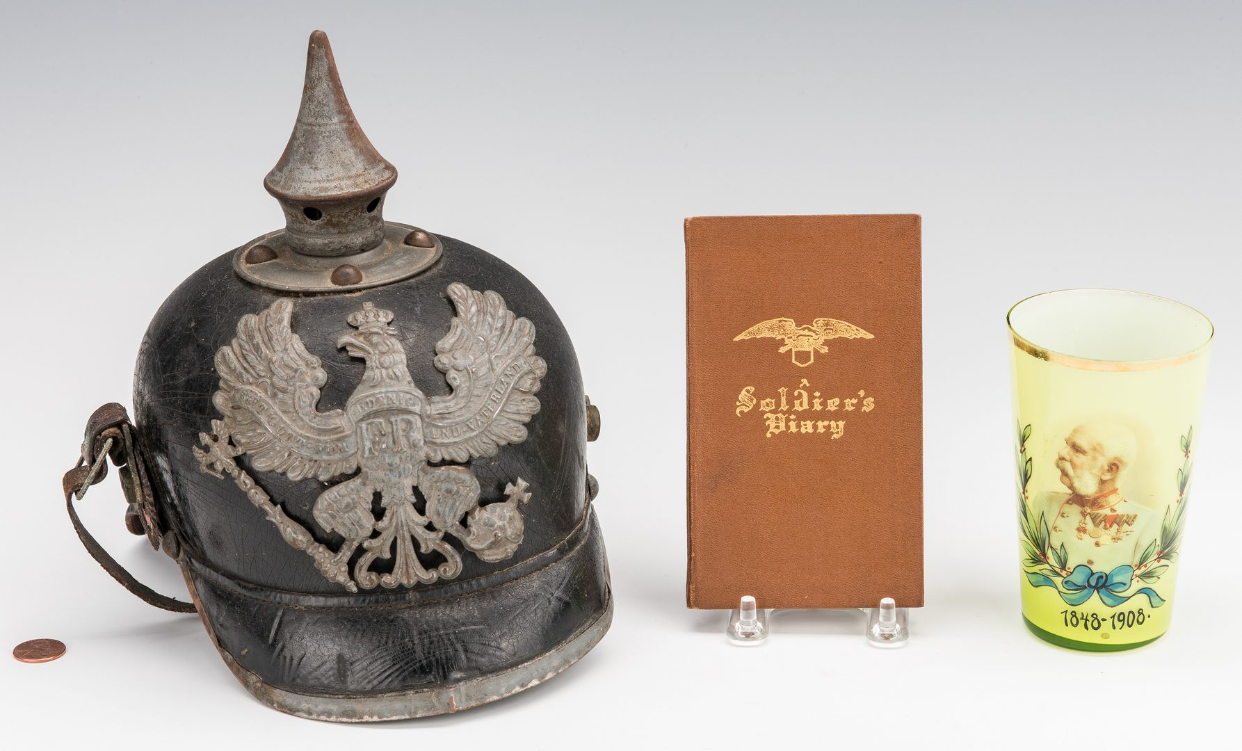Lot 828: German WWI Pickelhaube Helmet,  WWI autograph book & Glass
