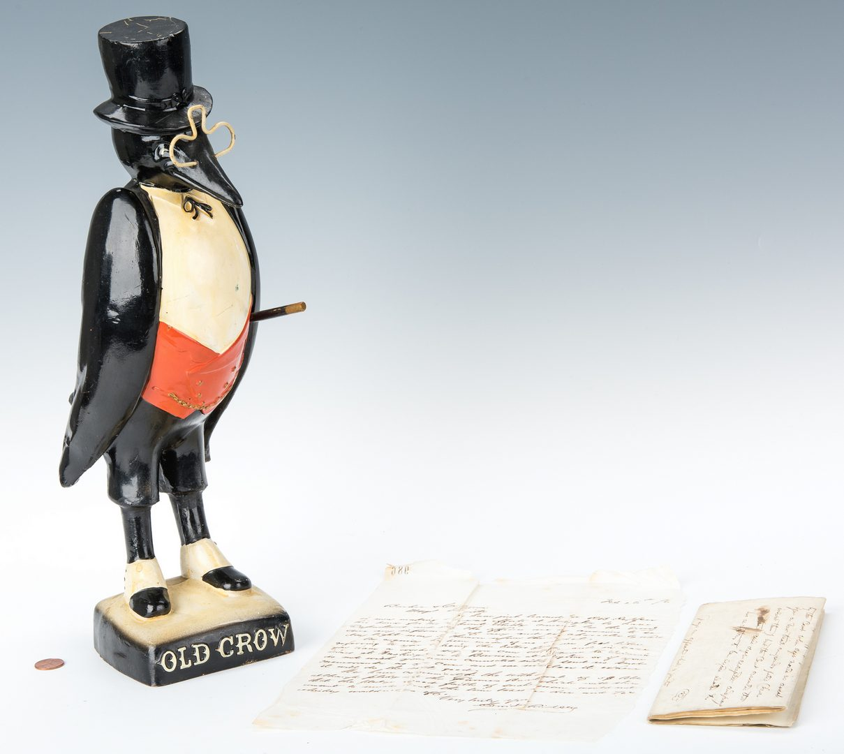 Lot 839: Old Crow Whiskey Figure & Documents, 3 items