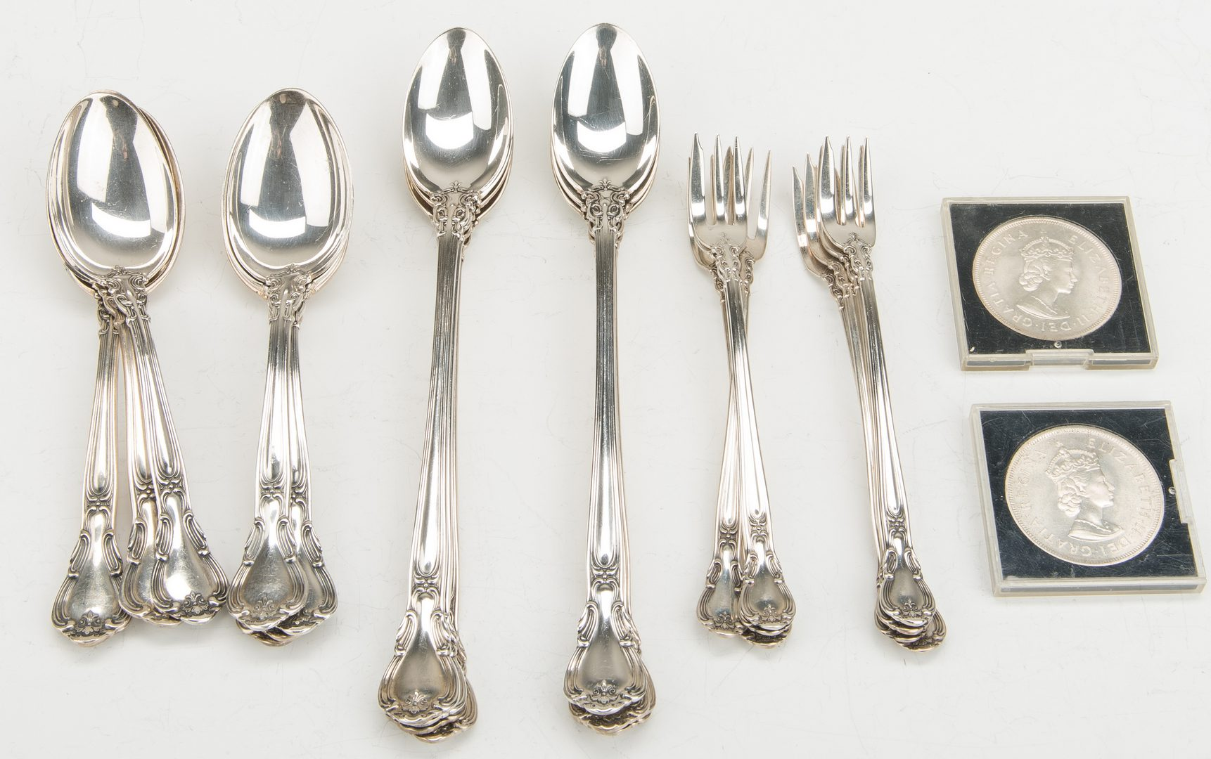 Lot 869: 24 Gorham Chantilly Sterling Flatware & 2 silver coins