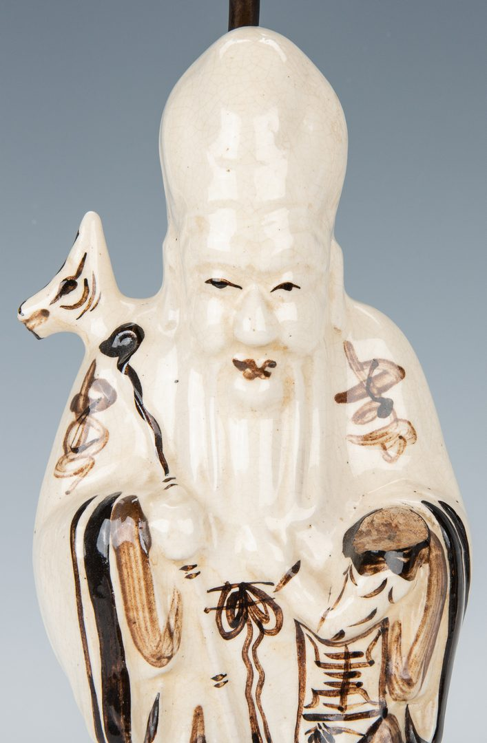 Lot 177: Buddha lamp and Japanese bone Inro