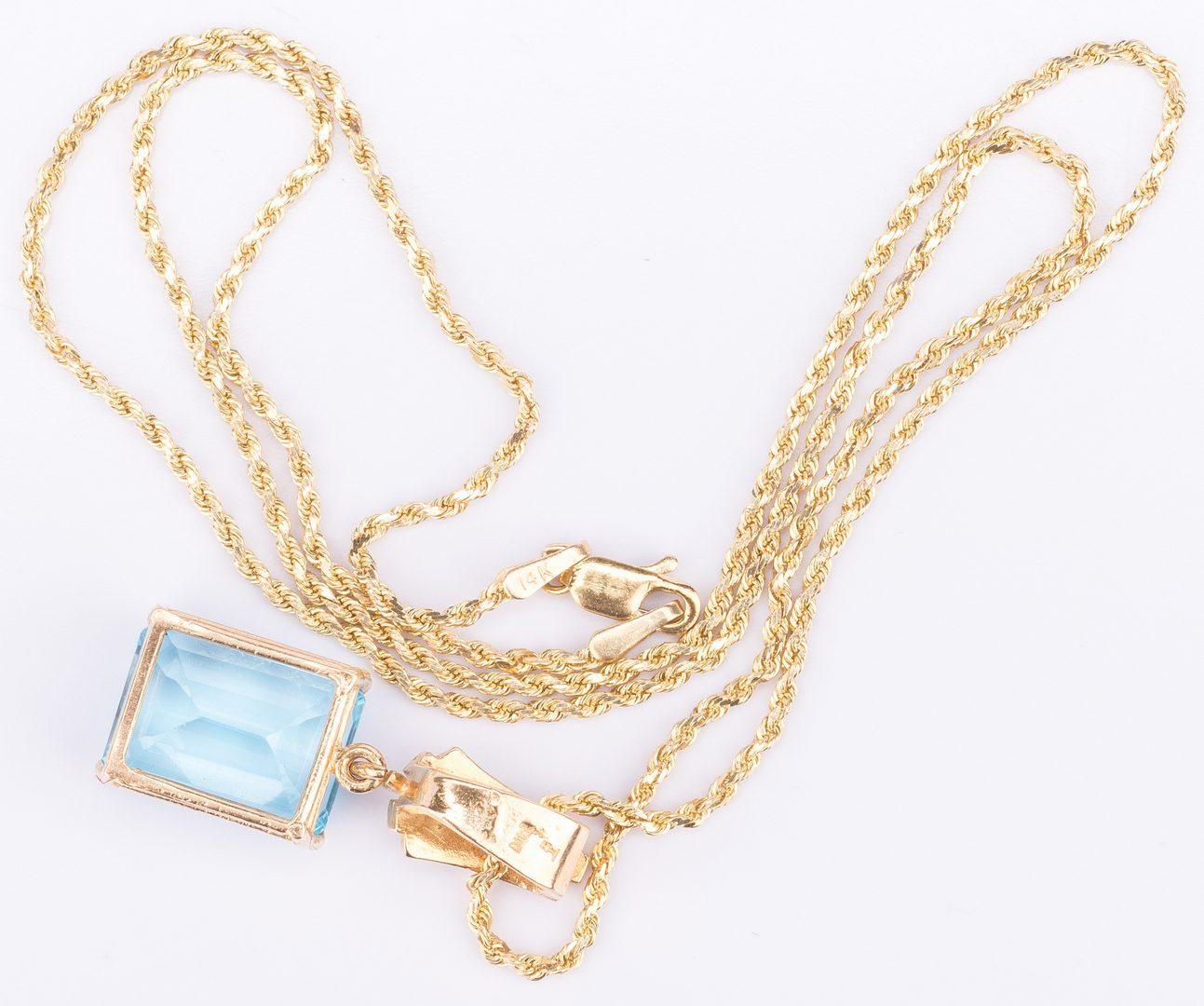 Lot 34: 14K Blue Topaz Enhancer, 20 inch rope chain
