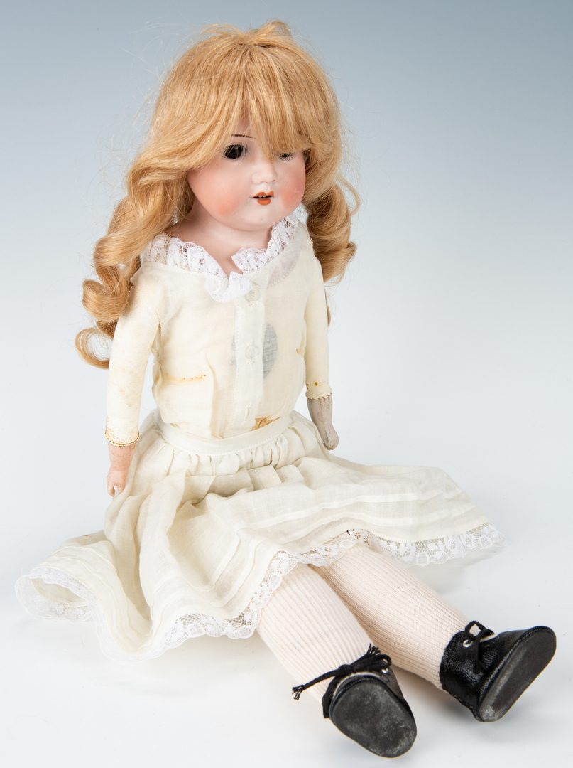 Lot 427: 2 German Dolls + 1 boy doll with dome