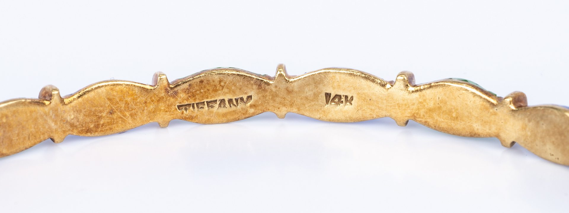 Lot 175: 2 Tiffany Gold Enamel Bangles