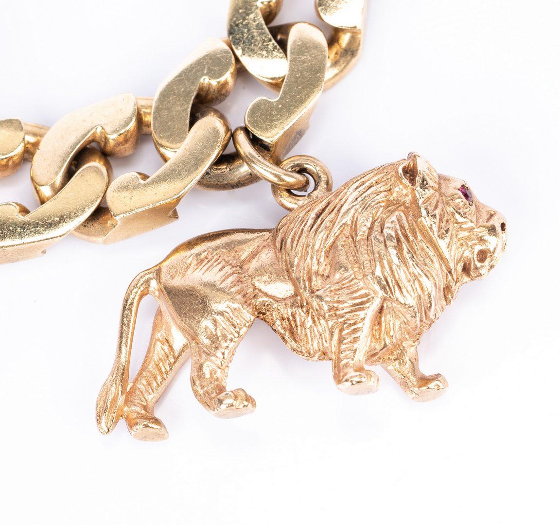 Lot 176: 14K Heavy Link Charm Bracelet, 172 g.
