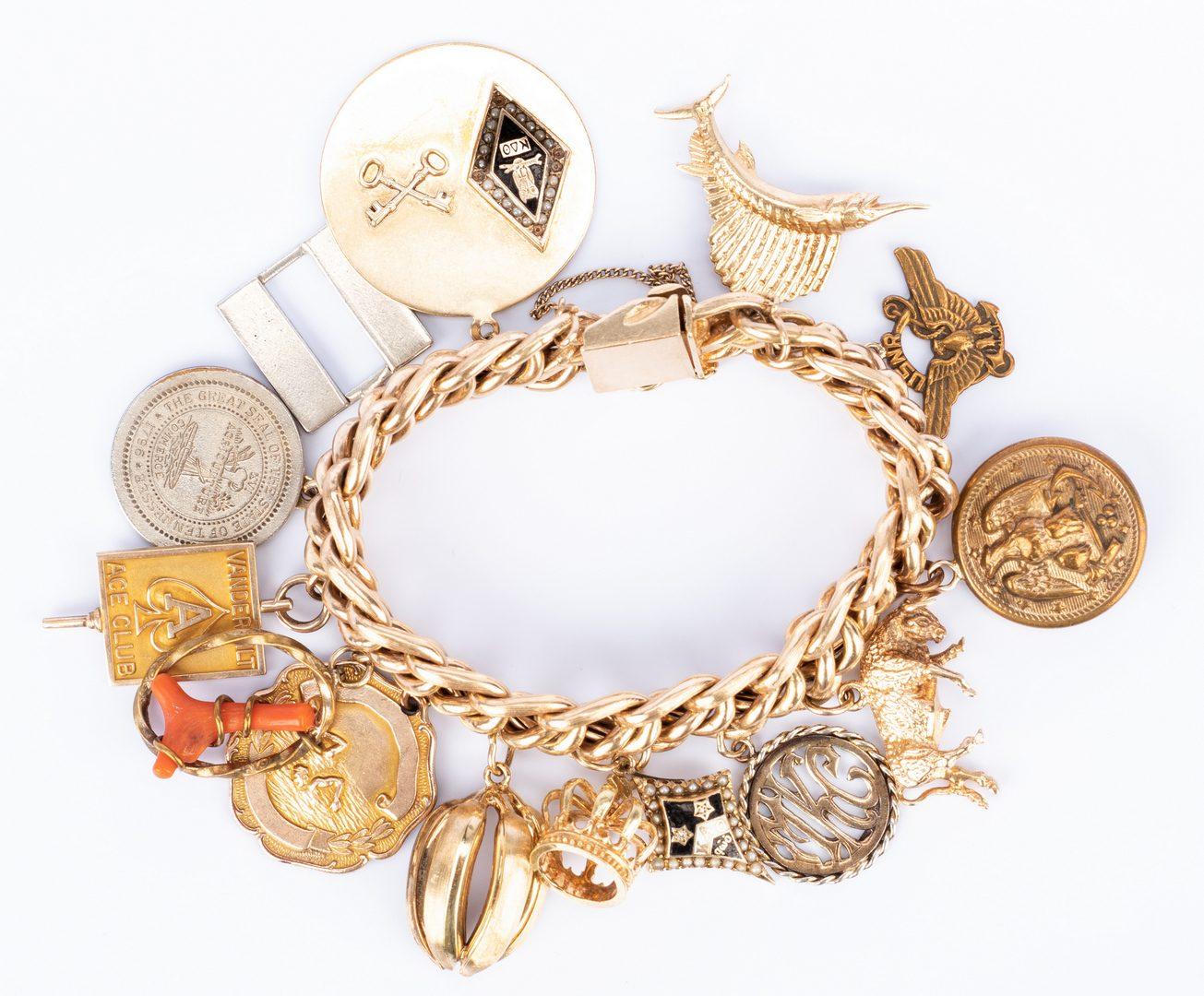 Lot 180: 14K Heavy Charm Bracelet