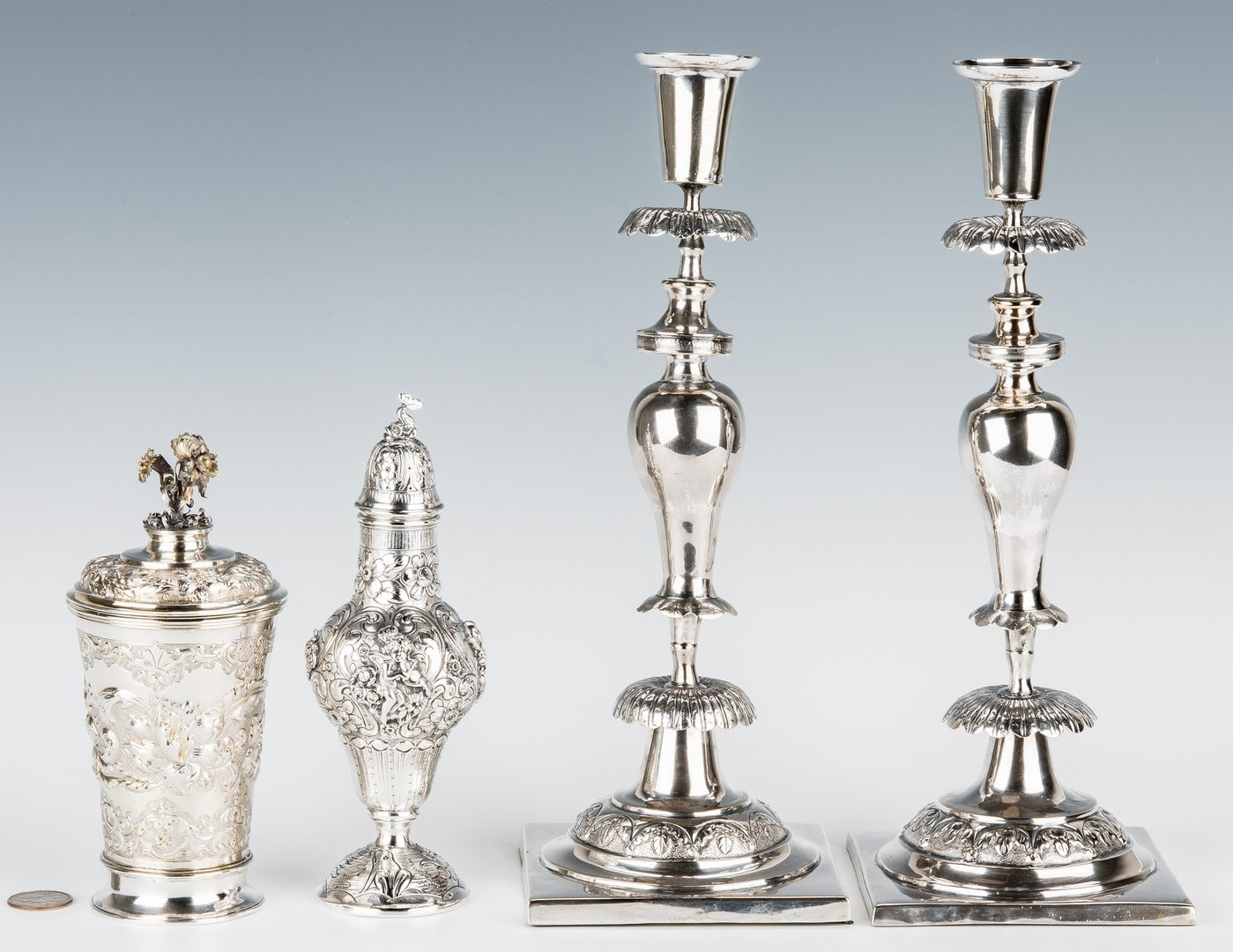 Lot 191: 4 Continental Silver items: Pair candlesticks, caster, cup and cover