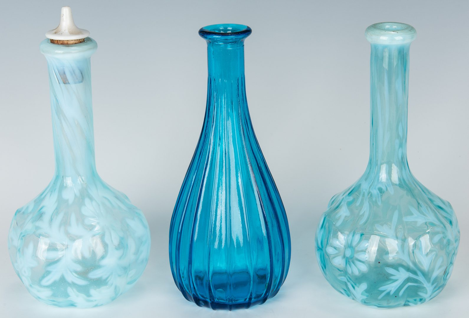 Lot 221: Collection of 15 Art Glass Barber Bottles