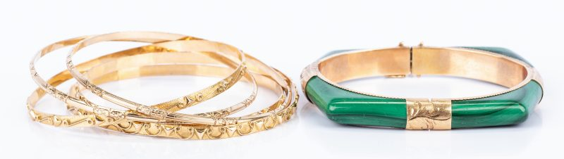 Lot 439: Group 14K Bangles incl. Malachite Bracelet