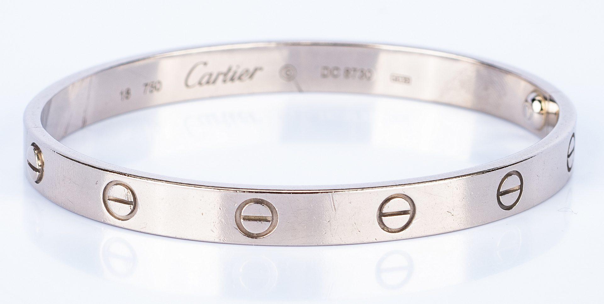 Lot 44: 18K Cartier Love Bangle; 14K Puzzle Ring
