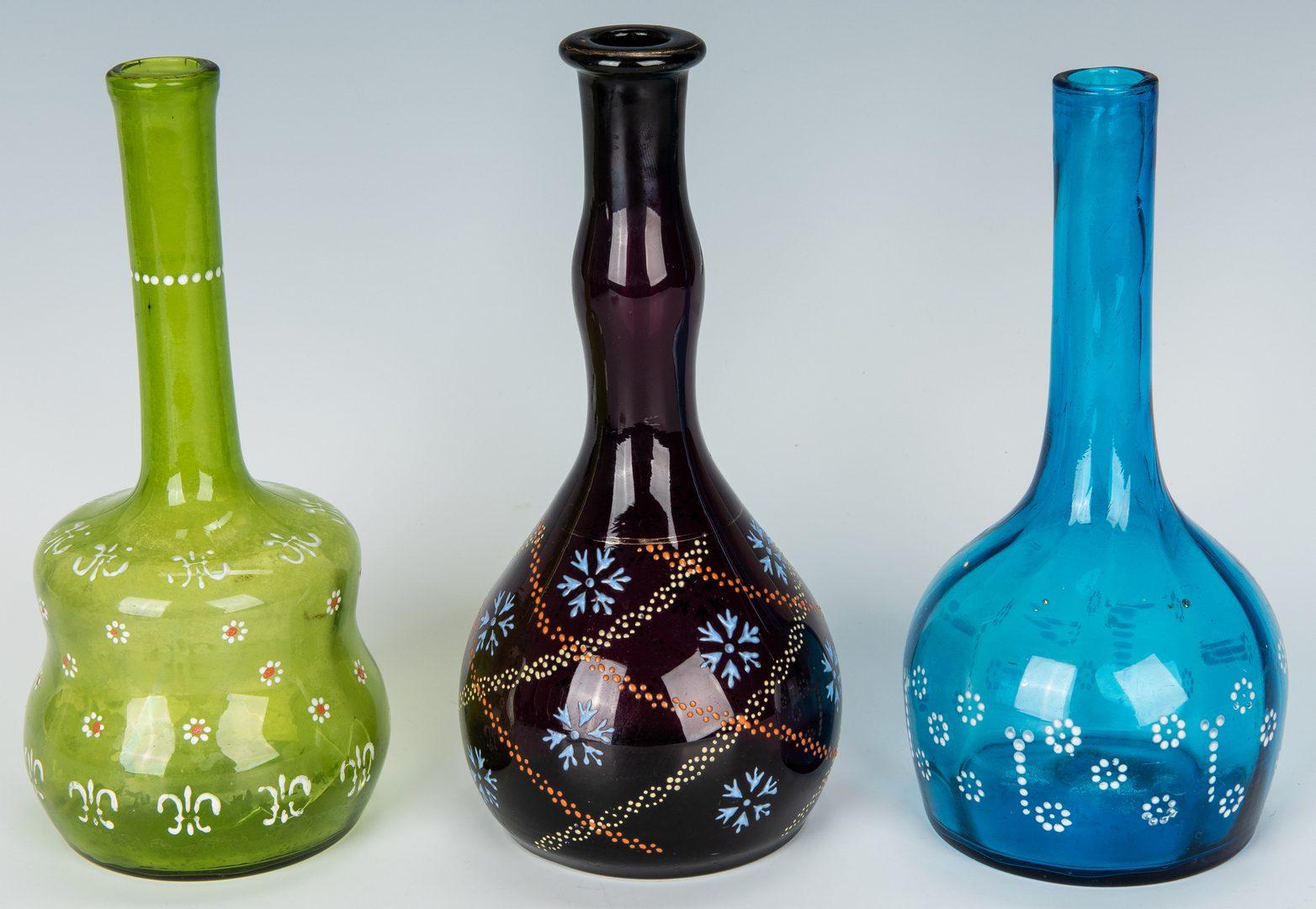 Lot 495: 10 Enameled Glass Barber Bottles