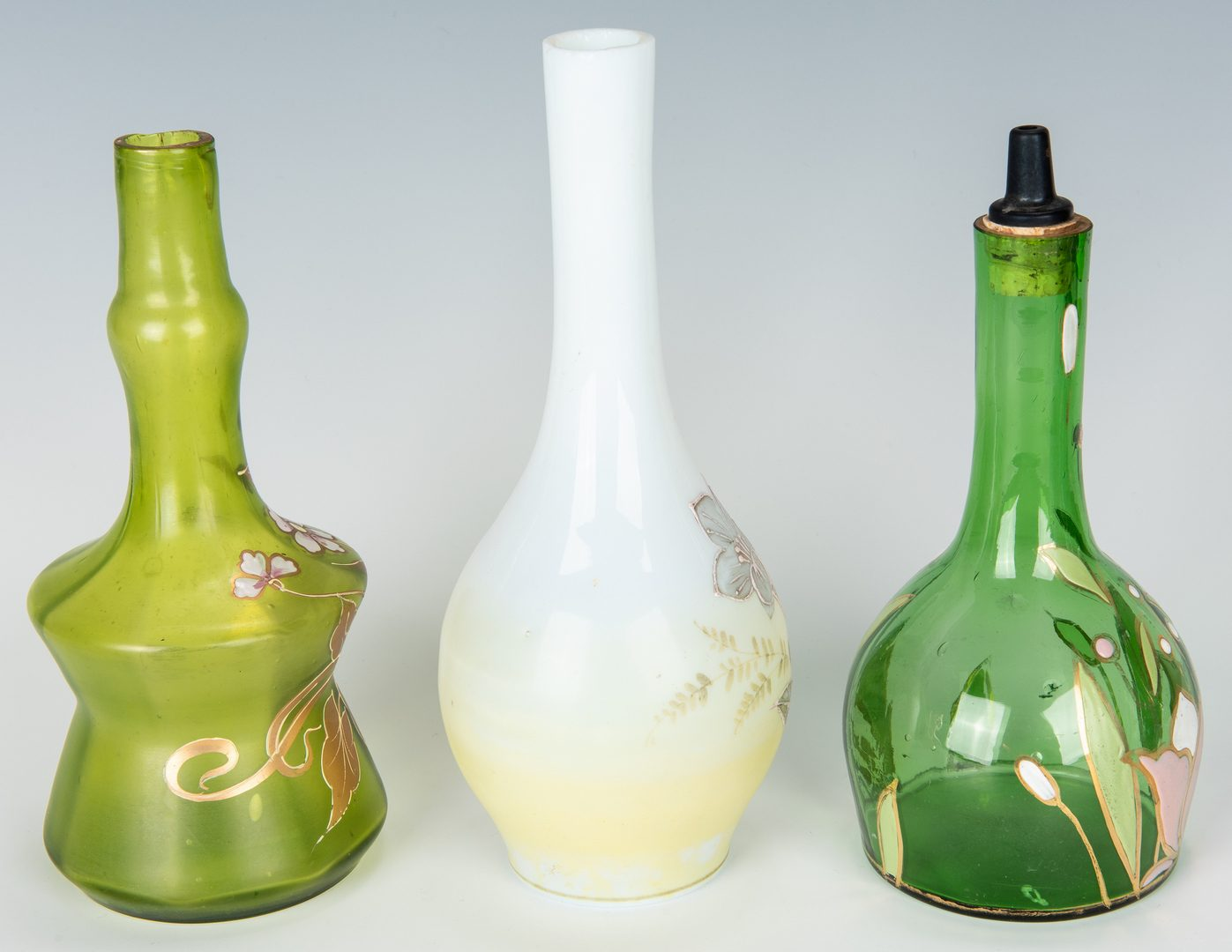 Lot 496: 9 Painted Glass Barber Bottles