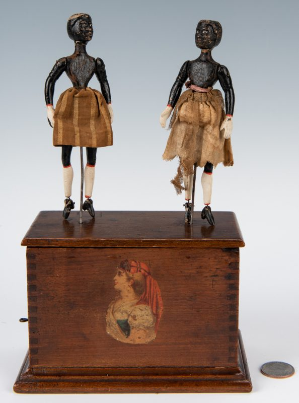 Lot 634: Black Americana Dancing Automaton