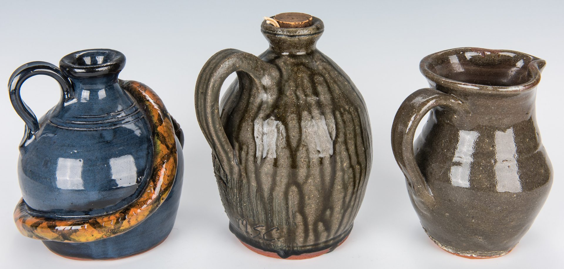 Lot 643: NC & GA Folk Pottery, 7 pieces incl. Face Jug