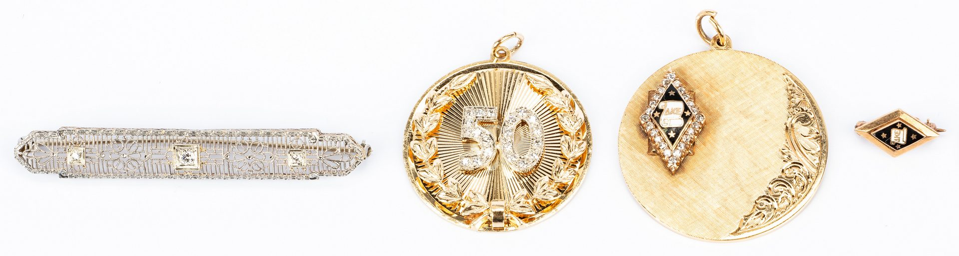 Lot 668: Assorted Gold and Diamond Vintage jewelry, 4 items