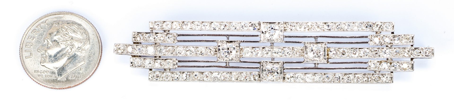 Lot 676: Art Deco Platinum Stacked Diamond Pin