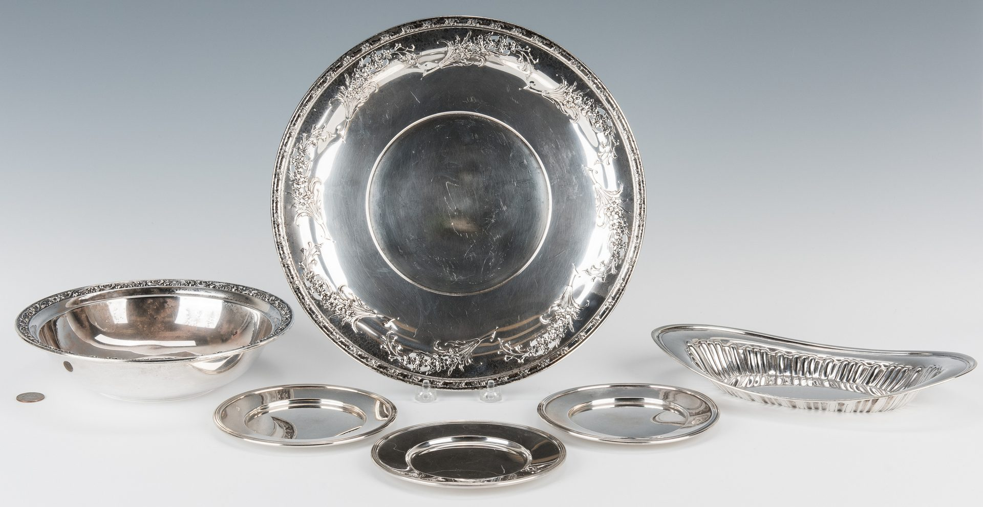 Lot 699: 6 Sterling Silver Serving Items