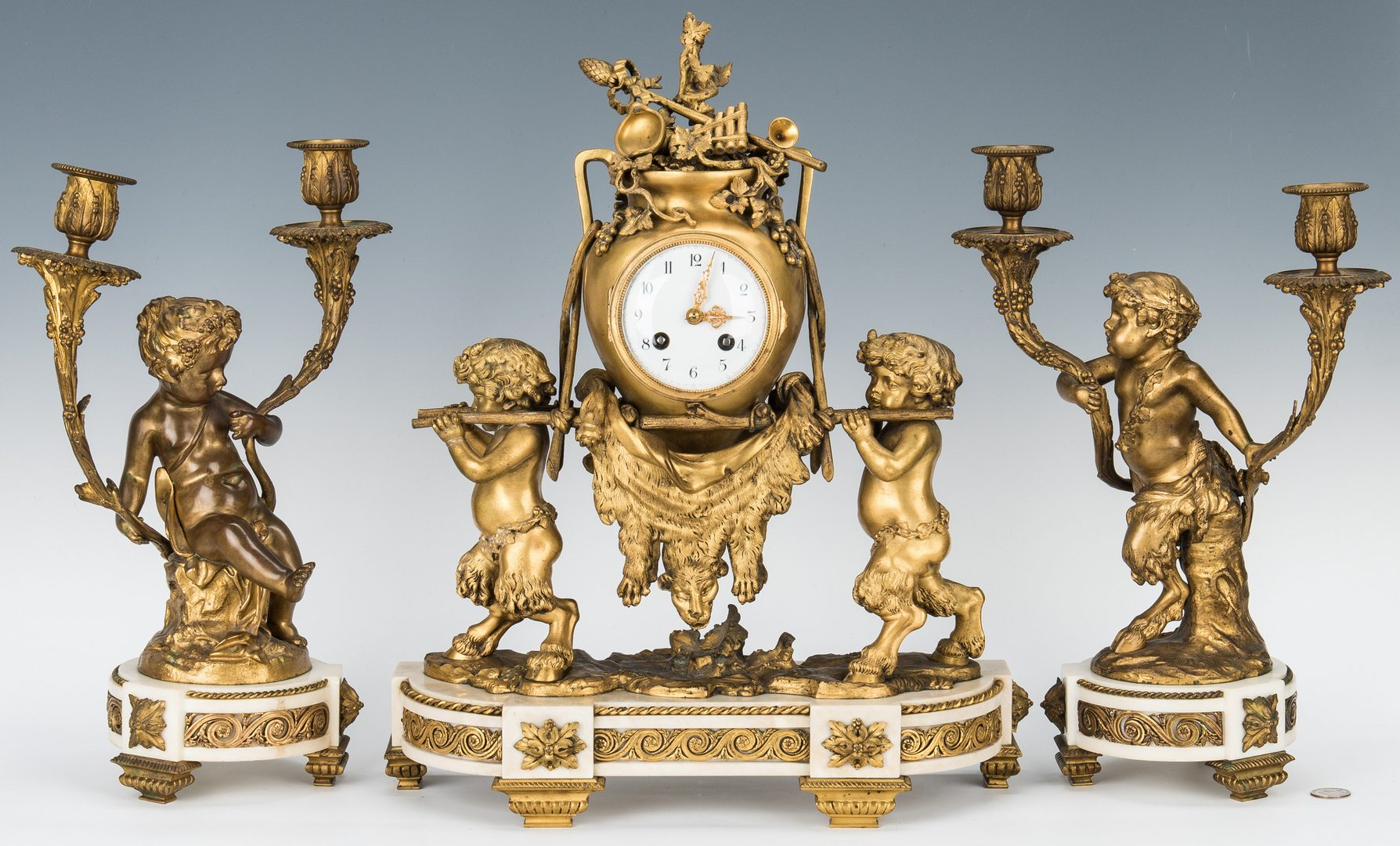Lot 70: French Ormolu Clock and Garniture, Clodion