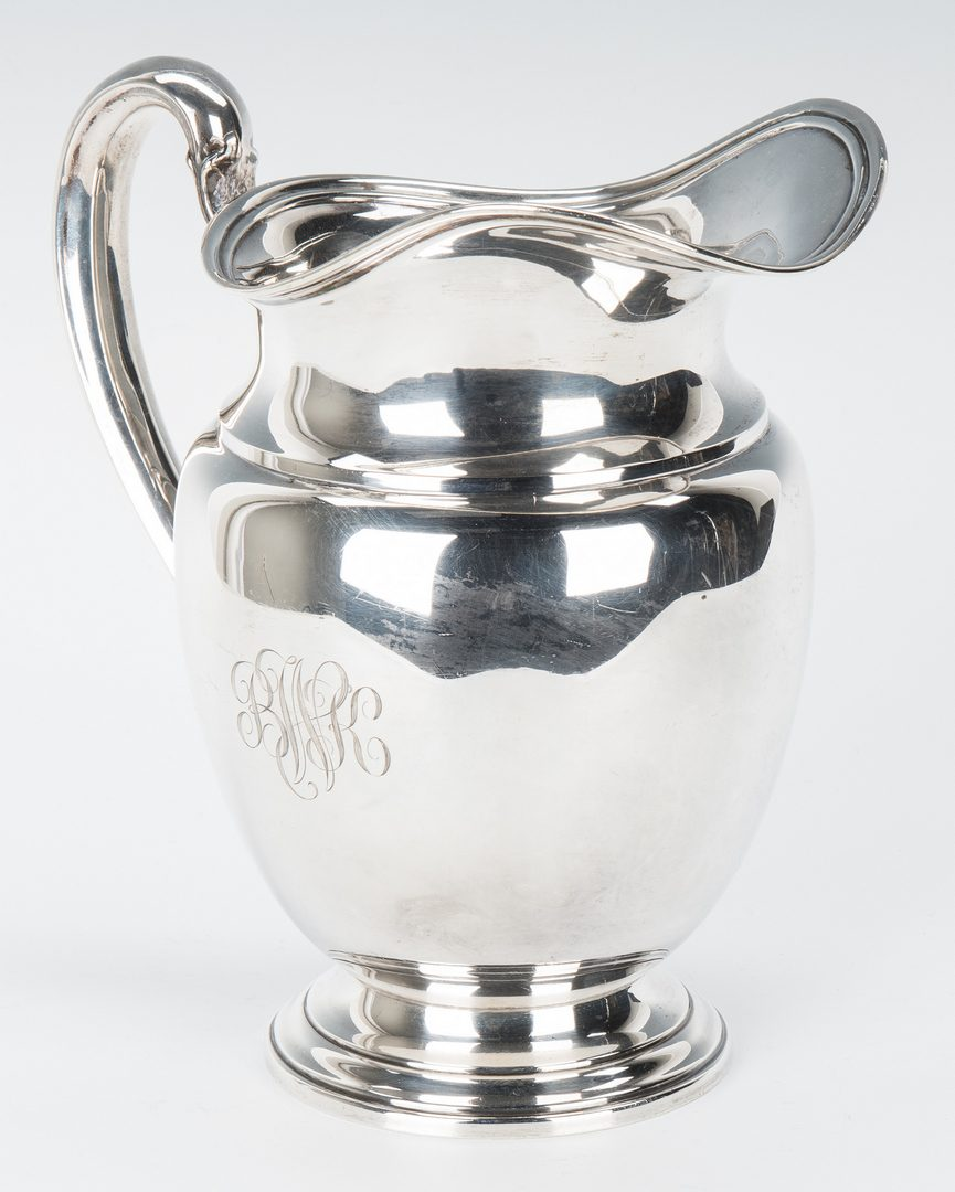 Lot 715: Sterling Silver Pitcher and Bread Plates, 9 items
